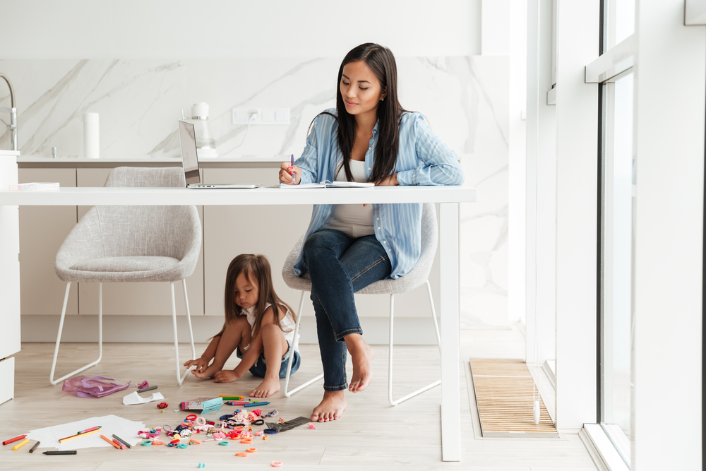 Mother journalling with children