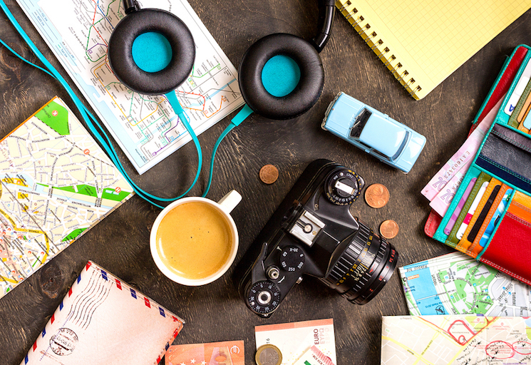 Holiday planning items scattered on a desk