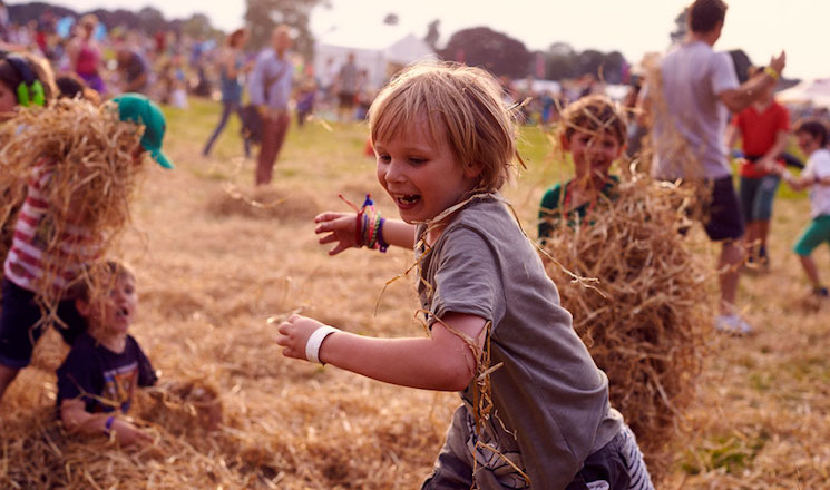 children playing with hay