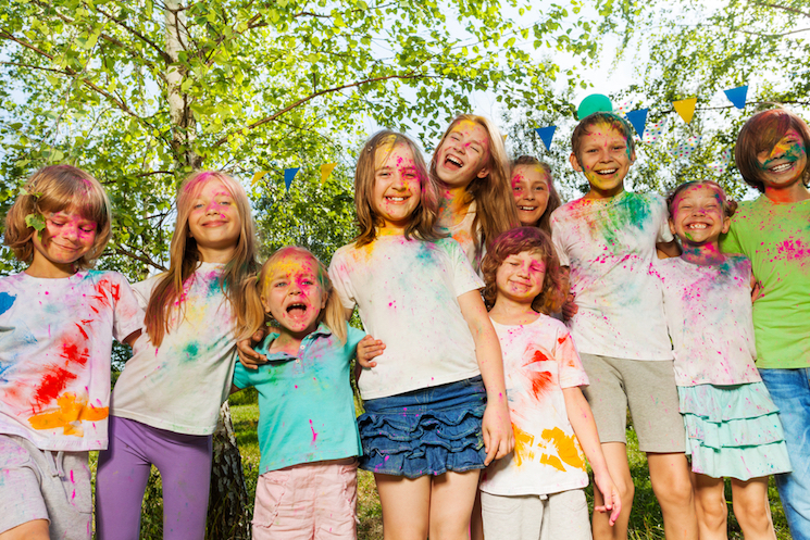 kids at a festival covered in paint