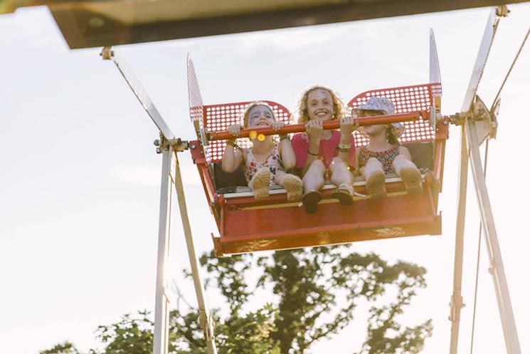 Group of girls on ferris wheel ride at Latitude Festival