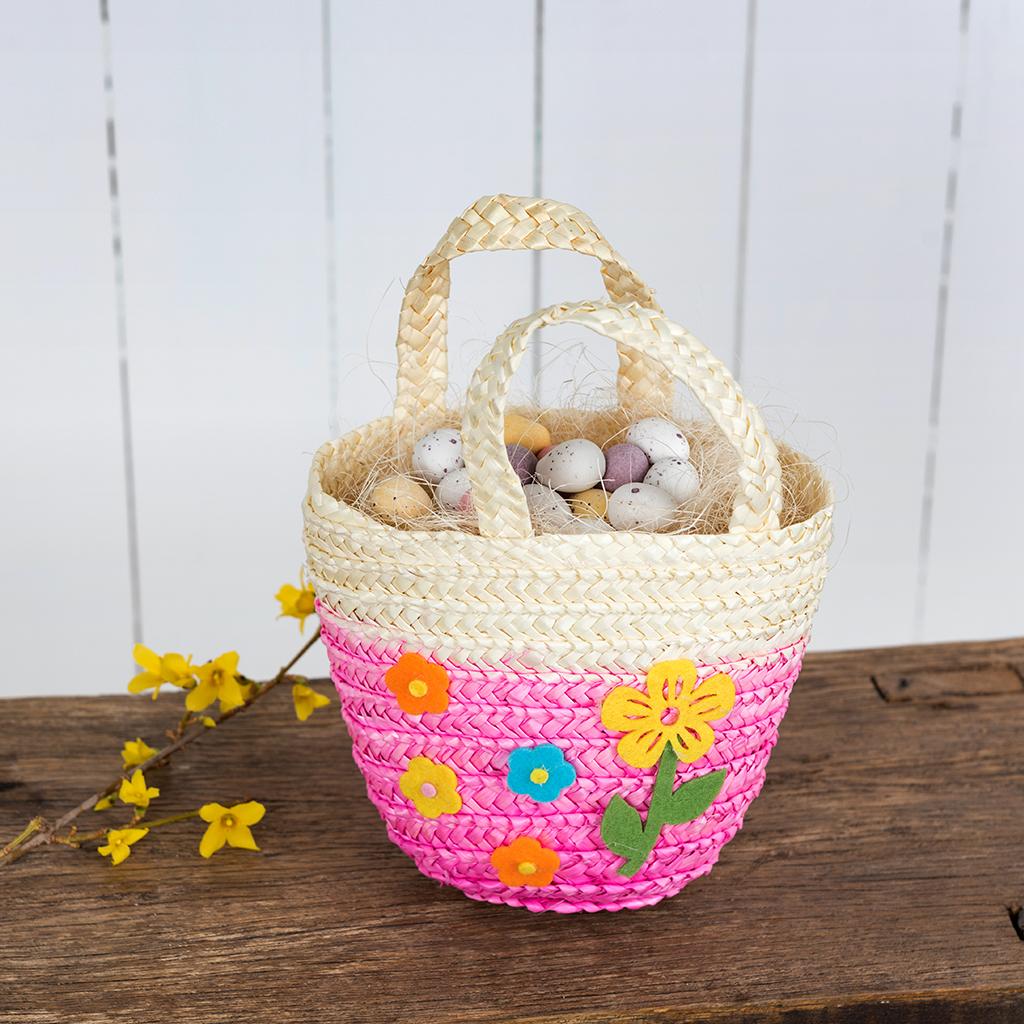 Pink woven flower basket rex london dotcomgiftshop pink childrens straw basket negle Choice Image