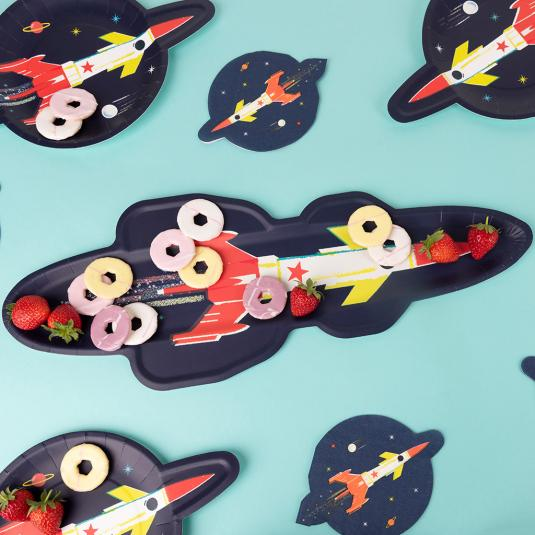 Paper platter in the shape of a rocket bursting through space.