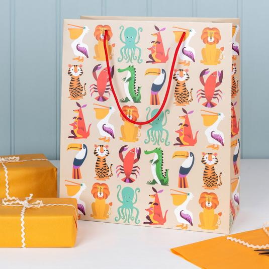 Large beige gift bag with colourful animals including lion, tiger, pelican, octopus, lobster, kangaroo and toucan.