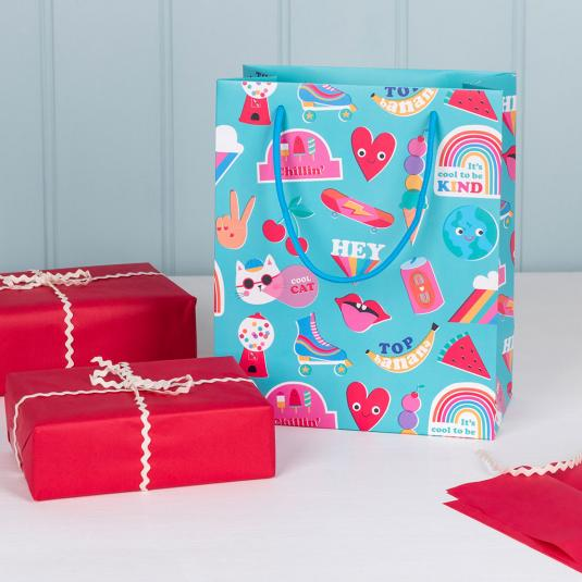 Small blue gift bag with colourful retro icons.