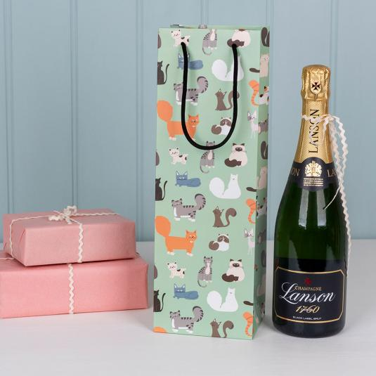 Bottle gift bag in pale green with cartoon cat breed pattern.