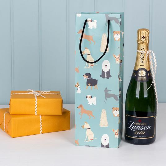 Bottle gift bag in pale blue with cartoon dog breed pattern.