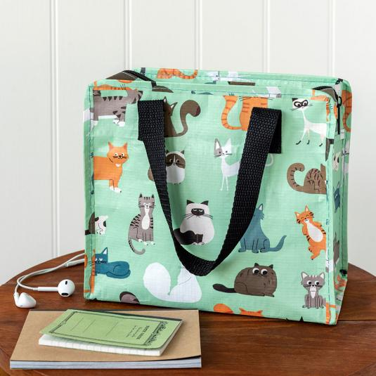 Small recycled plastic bag with black zip and nylon handles. Bag is light green with a cartoon cat breed pattern.