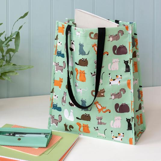 Light green recycled plastic shopping bag with cartoon cat breed pattern and black nylon handles.
