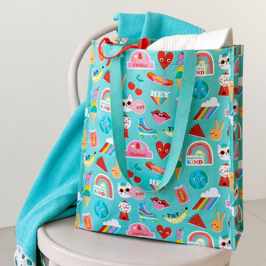 Turquoise recycled plastic shopping bag with colourful retro icon pattern and nylon handles.