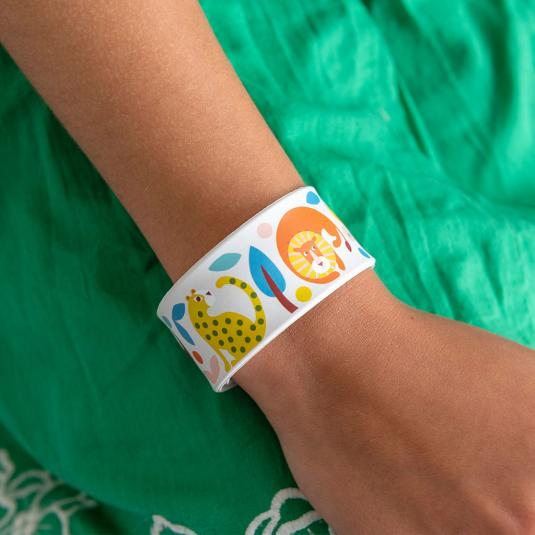 Snap band on child's wrist with cute jungle animals print.