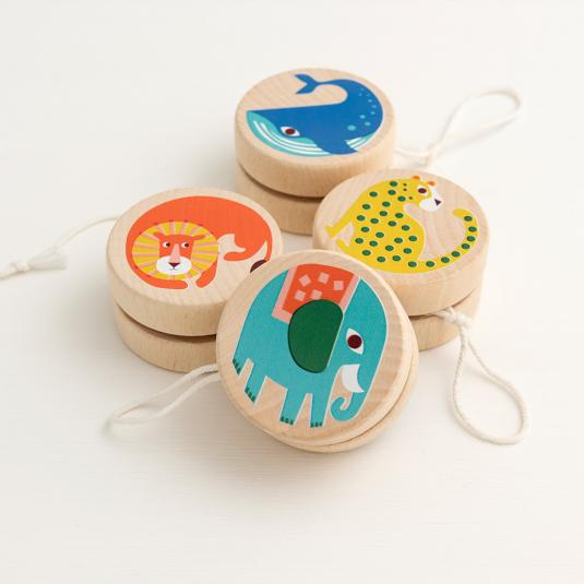 Wooden yoyos with colourful animals. Lion, whale, elephant and leopard.