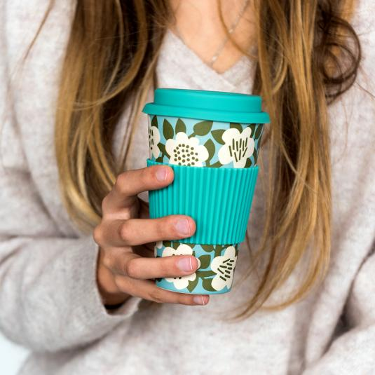 Green and cream floral bamboo fibre travel mug with silicone lid and sleeve