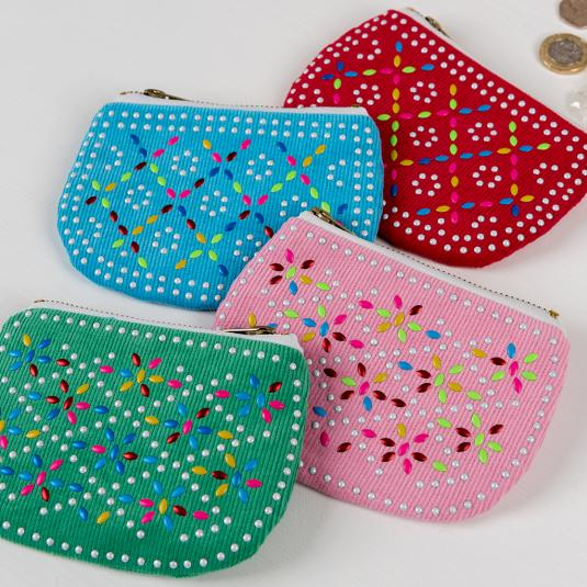 Colourful beaded purses in four colours