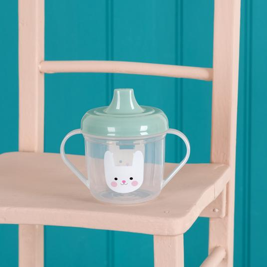 toddlers' sippy cup with green lid and white bunny face printed