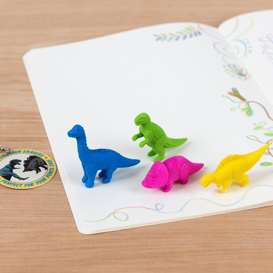 Set of four colourful dinosaur erasers in plastic purse