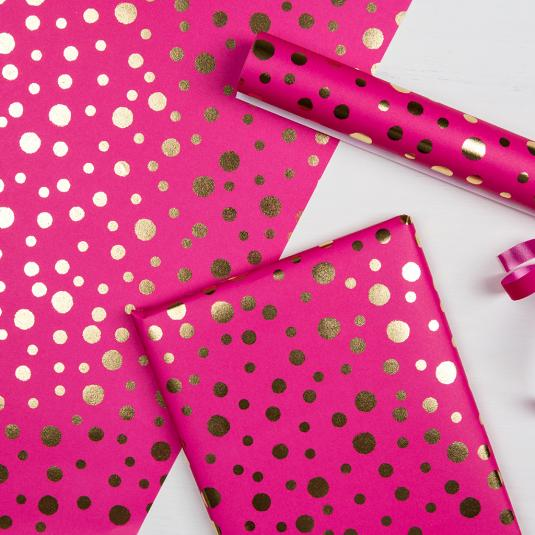 Gold spots print pink gift wrapping paper