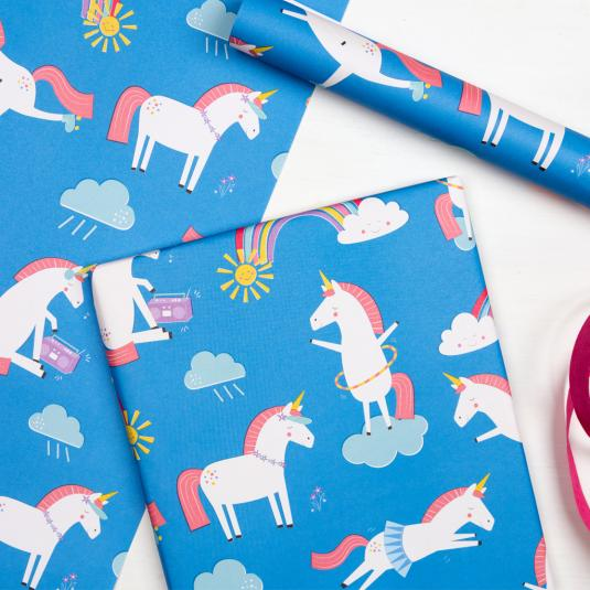 Unicorn and rainbow print blue kids gift wrapping paper