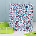 Large white gift bag with blue flower and deep purple leaves pattern.