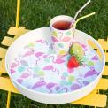 pink flamingo serving tray and a bamboo cup