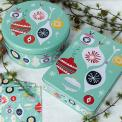 Christmas cake and biscuit tins in mint green bauble print