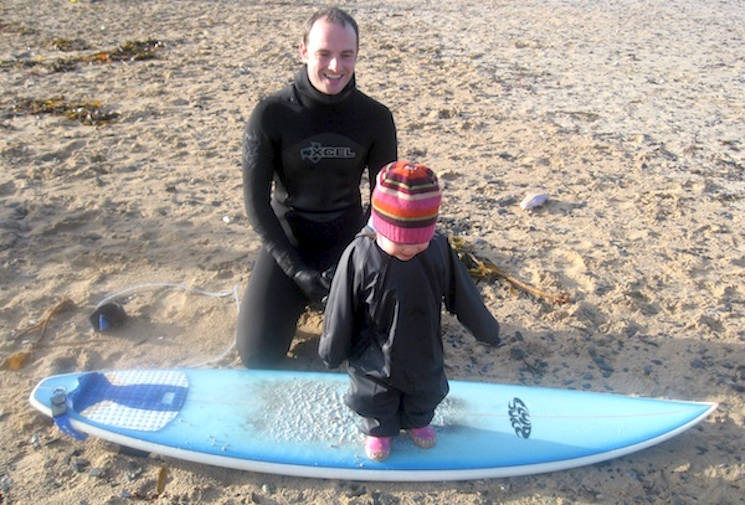Andrew, daughter and surfboard