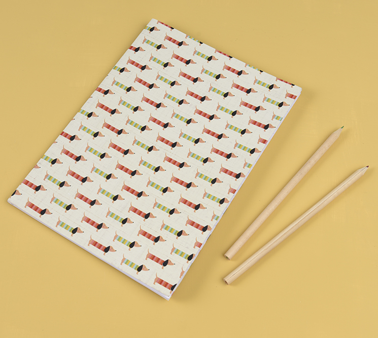 Notebook covered in Sausage Dog washi tape